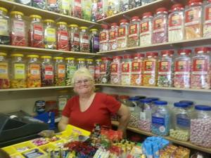 Sandra the sweet lady from Candy Stripes sweet shop.